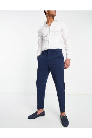 River Island Hombre Pantalones chinos - Pantalones azules de corte tapered de sarga de