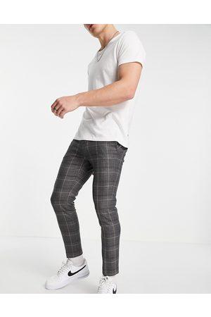 River Island Hombre Pantalones chinos - Pantalones de vestir de corte tapered con cuadros grises de