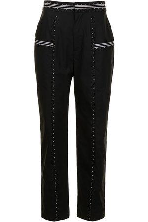 Twin-Set Mujer Pantalones y Leggings - Pantalones ajustados con apliques