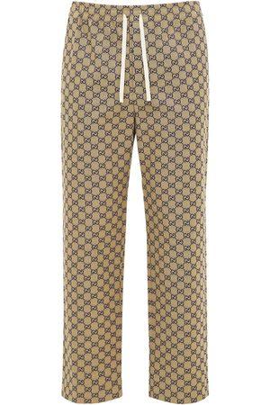 Gucci | Hombre Pantalones De Lona Con Piel Y G Entrelazada 44