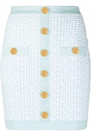 Balmain Falda corta ajustada con botones decorados