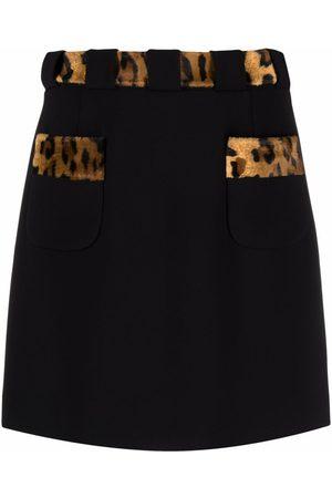 Moschino Minifalda con estampado de leopardo