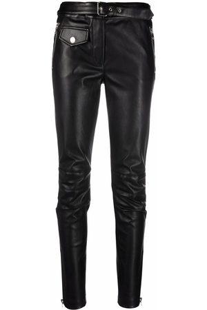 Moschino Pantalones slim de piel artificial