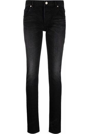 Balmain Faded-effect skinny jeans