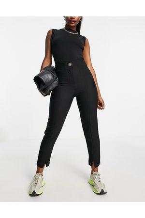 River Island Mujer Pantalones slim y skinny - Pantalones cigarette negros de sastre con aberturas en la parte delantera de