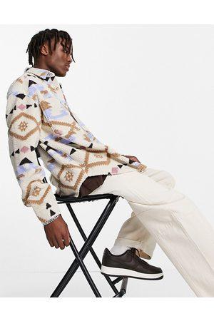 ASOS Camisa extragrande de estilo años 90 con estampado de inspiración azteca de borreguito de