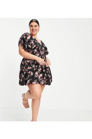ASOS Vestido corto oscuro con detalle de botones, falda abullonada y estampado floral de ASOS DESIGN Curve-Multicolor