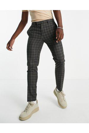 River Island Pantalones pitillo grises con diseño a cuadros de
