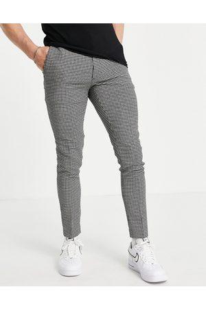 ASOS Pantalones de vestir negros superpitillo con estampado de pata de gallo de mezcla de lana de