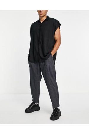 ASOS Pantalones de vestir a rayas de corte tapered extragrande de