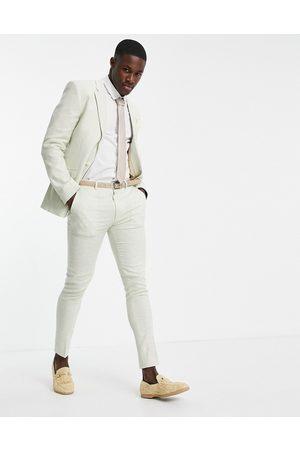 ASOS Pantalones de traje verdes de corte muy pitillo con estampado de pata de gallo de lino de Wedding