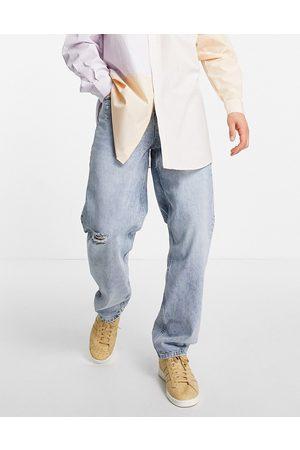 ASOS Vaqueros con lavado claro y diseño rasgado de corte holgado y estilo años 90 de -Azul