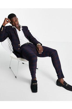 ASOS Pantalones de traje azules de corte muy entallado con diseño de cuadros medianos y botón dorado de -Rojo