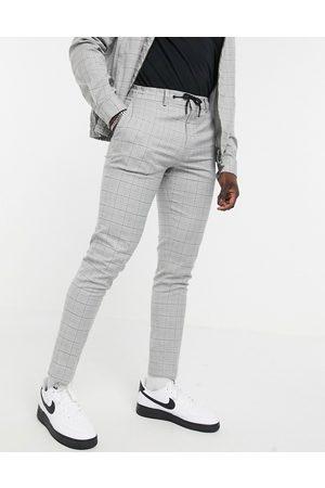 ASOS Hombre Pantalones chinos - Pantalones de vestir grises jaspeados a cuadros de corte pitillo con cordón ajustable en la cintura de (parte de un conjunto)-Marrón