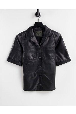 Muubaa Camisa negra de cuero de