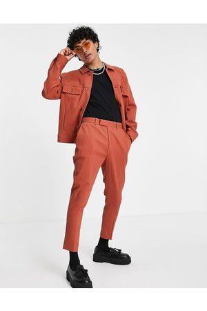 ASOS Pantalones de vestir color óxido de corte tapered pitillo con acabado rugoso de (parte de un conjunto)-Marrón