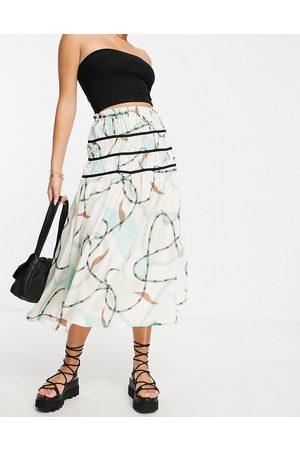 ASOS Mujer Estampadas - Falda midi con estampado abstracto y detalles en contraste de