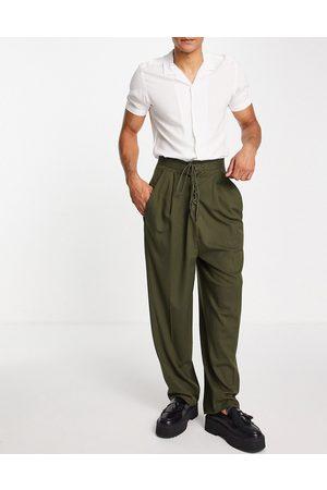 ASOS Pantalones de vestir caquis de pernera abombada con detalle retorcido de -Verde