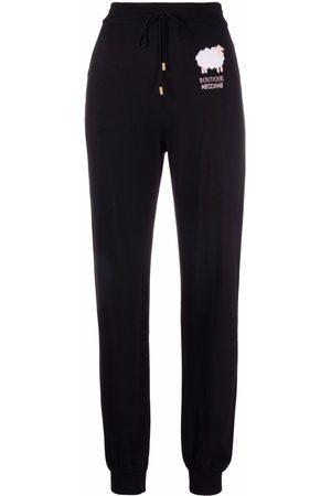 Moschino Mujer Pantalones slim y skinny - Pantalones joggers con logo estampado