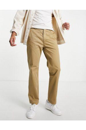 Levi's Pantalones de oficina dorado de corte estándar tapered de sarga de Levi's Skateboarding