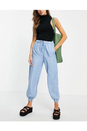 MANGO Pantalones azules con bajos ajustados y cierre de cordón ajustable de