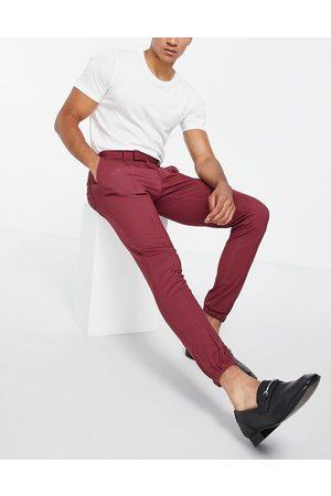 ASOS Pantalones de vestir de corte pitillo y línea sartorial casual con bajos ajustados de punto de -Rojo
