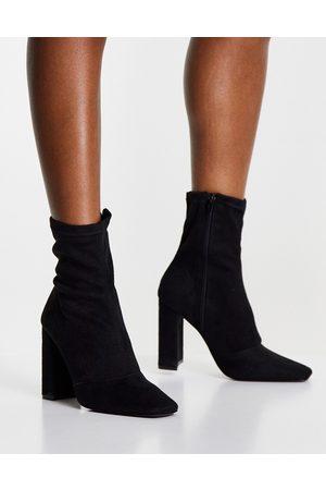 ASOS Botas negras estilo calcetín con tacón de bloque Effect de