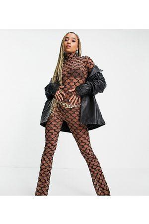 Juicy Couture Pantalones negros con diseño de monograma de malla de x ASOS (parte de un conjunto)