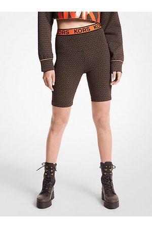 Michael Kors Mujer Pantalones - MKPantalón de ciclista de nailon elástico con logotipo - Chocolate - Michael Kors
