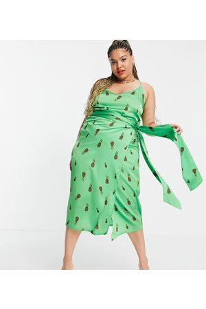 Never Fully Dressed Mujer Estampadas - Falda midi verde cruzada con estampado de piñas estilo leopardo de satén de (parte de un conjunto)