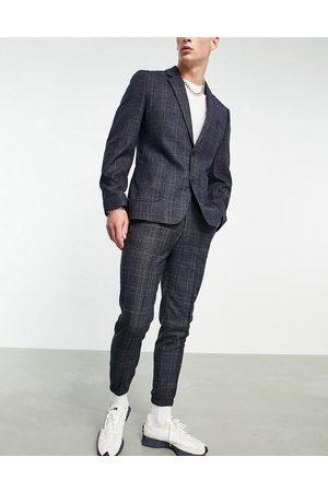 ASOS Pantalones de traje a cuadros de corte tapered con bajos ajustados de
