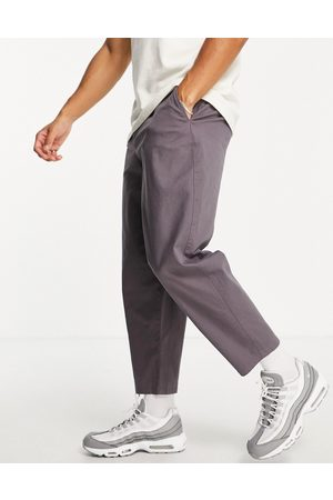 ASOS DESIGN Hombre Pantalones chinos - Chinos gris carbón de corte abombado de -Violeta