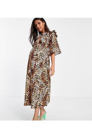 Queen Bee Vestido midi con estampado de leopardo con lazada en el cuello y detalle de volantes exclusivo de