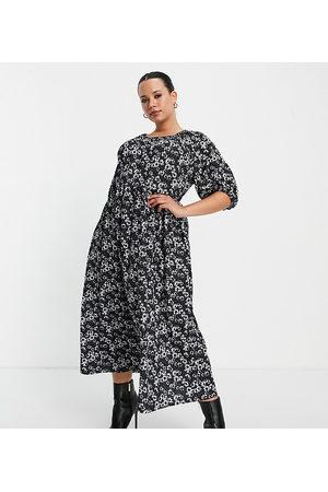ASOS Mujer Casual - Vestido midi negro amplio con estampado de margaritas blancas y mangas abullonadas cortas de ASOS DESIGN Curve