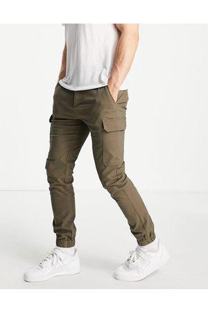 ASOS Pantalones cargo caquis de corte pitillo con bajos ajustados de -Verde