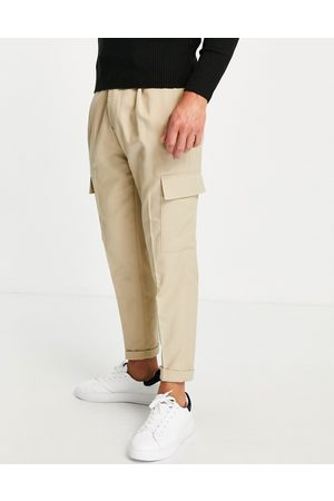 Topman Pantalones color cargo de corte tapered de sarga de -Beis neutro