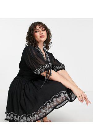 ASOS Mujer De noche - Vestido corto con cuello bordado y lazadas en las mangas de ASOS DESIGN Curve