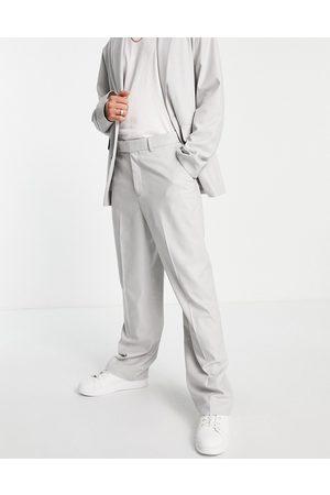 ASOS Pantalones de traje grises de pernera ancha de tejido microtexturizado de