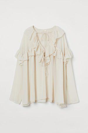 H&M Blusa de algodón con volantes