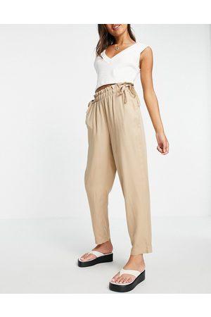 VERO MODA Pantalones color de corte pitillo con cinturilla paperbag de -Marrón