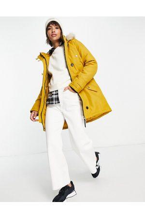 VERO MODA Parka amarilla con capucha con forro de piel sintética de -Naranja