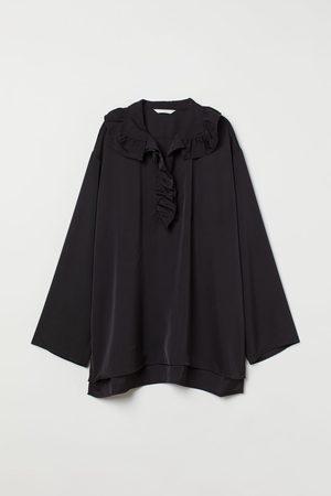 H & M Blusa con cuello de volante