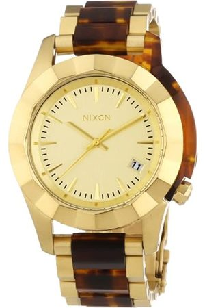Nixon Monarch Gold/Molasses - Reloj de Cuarzo para Mujer, con Correa de Diversos Materiales