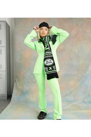 COLLUSION Pantalones de campana verde neón de corte superslim de