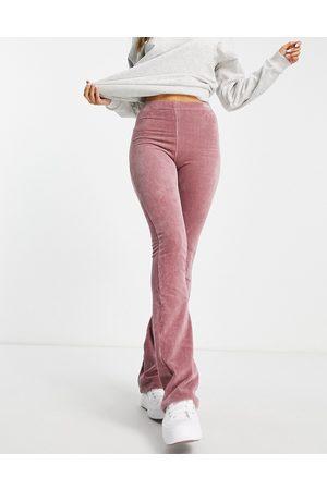 Topshop Pantalones rosas de campana de pana elástica de